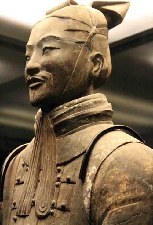 Detail of facial features and clothing of clay warrior