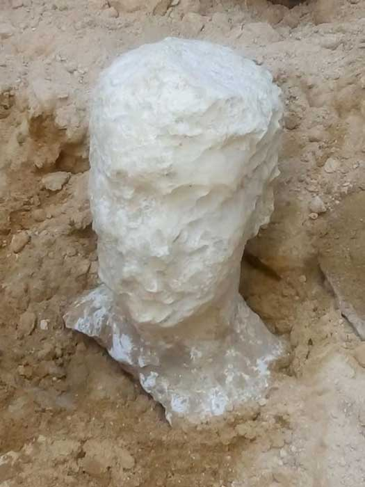 Deteriorated alabaster bust of a man was found with the coffin. (Ministry of Antiquities)