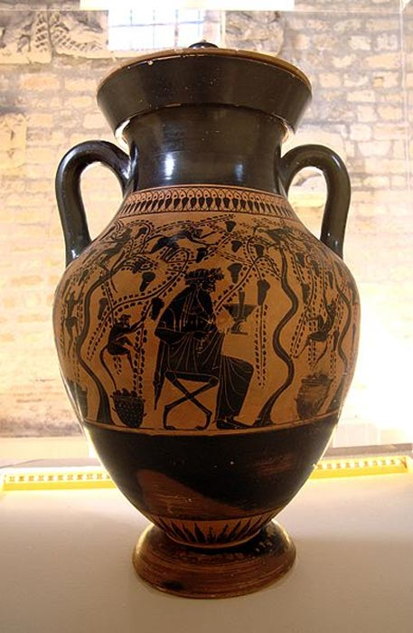 Dionysus with sileni in a vineyard. Attic black-figure amphora attributed to the Priam Painter, (6th century BC). From Monte Abetone (Etruria). Museo Nazionale di Villa Giulia (Rome).