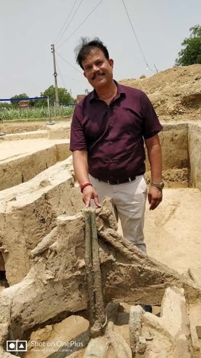 Dr. Sanjay Kumar Manjul at the Sanauli site pointing out the copper pole of the chariot. (Outlookindia, Author provided)