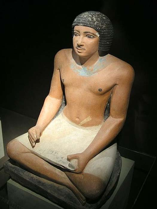 Seated statue of an Egyptian scribe found in the Western cemetery at Giza; 5th dynasty.
