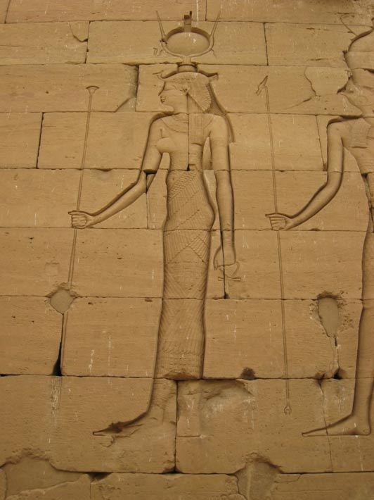 An ancient Egyptian temple relief of Isis, whom Cleopatra thought she was. Note the ureaus or snake symbol on her head.