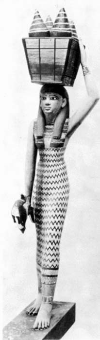 Egyptian woman carrying goods. Figurine from an 11th dynasty offering.
