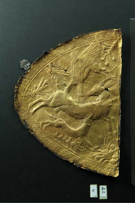 Embossed gold application with motif of animal combat of Levantine origin.