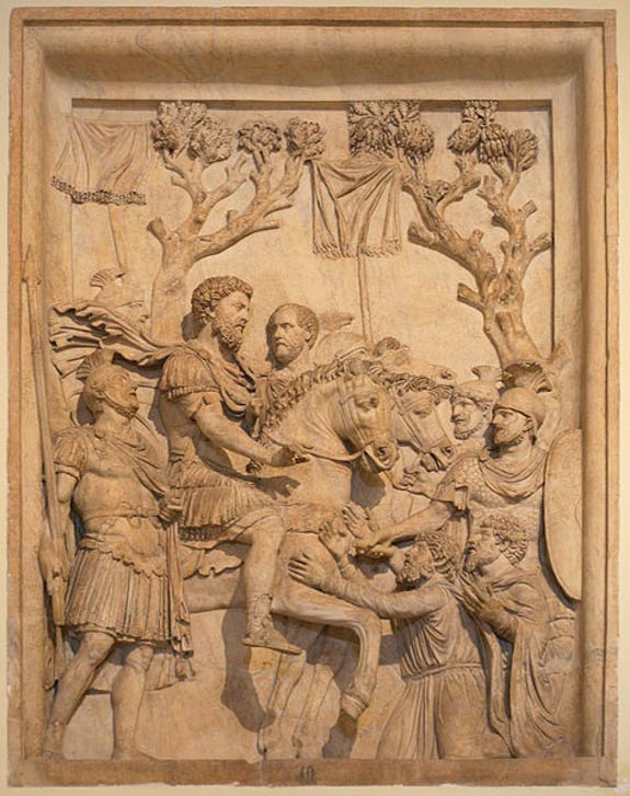 Emperor Marcus Aurelius showing clemency to the defeated Germanic tribes. Bas-relief from the arch of Marcus Aurelius, Rome.