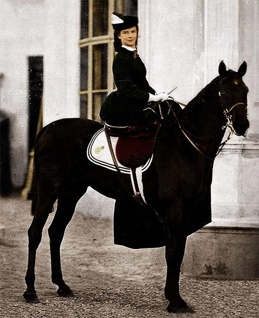 The Empress of the Hapsburg Empire, Elisabeth Amelie Eugenie of Wittelsbach, known as Sissi, posing on a horse in 1896 in Biarritz, France. (Unidentified photographer / Public domain)