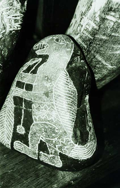Engraved stone depicting a saurian or dinosaur.