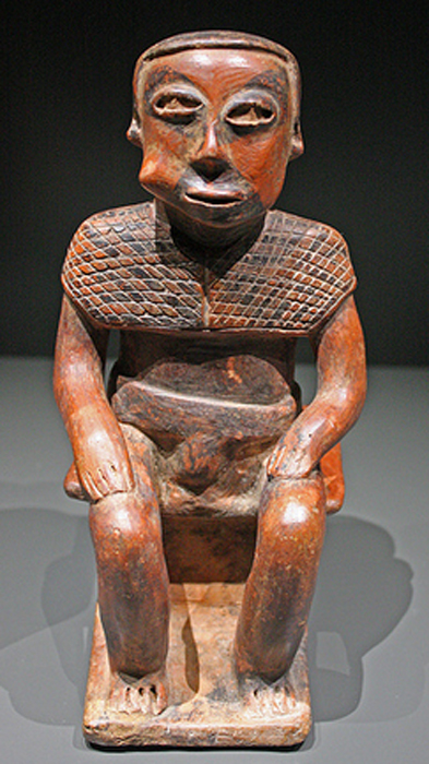 Example of a terracotta statuette of a coca leaf chewing figure from the Nariño culture, Colombia.