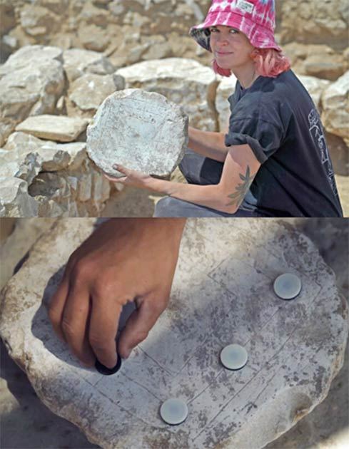 An excavation volunteer holding up an ancient game board found at the Rahat site. Soap production meant workers had idle time for games while they waited for the next stage in the manufacturing process. (Emil Aladjem/Israel Antiquities Authority)