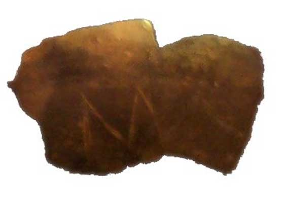 "Fragment of a clay vessel of the Vinča Culture with an ""M""-looking incision."