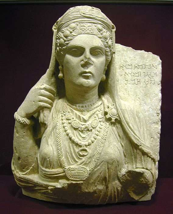 Funerary bust of Aqmat, daughter of Hagagu, descendant of Zebida, descendant of Ma'an, with Palmyrenian inscription. Stone, late 2nd century AD. From Palmyra, Syria. (CC BY SA 3.0)