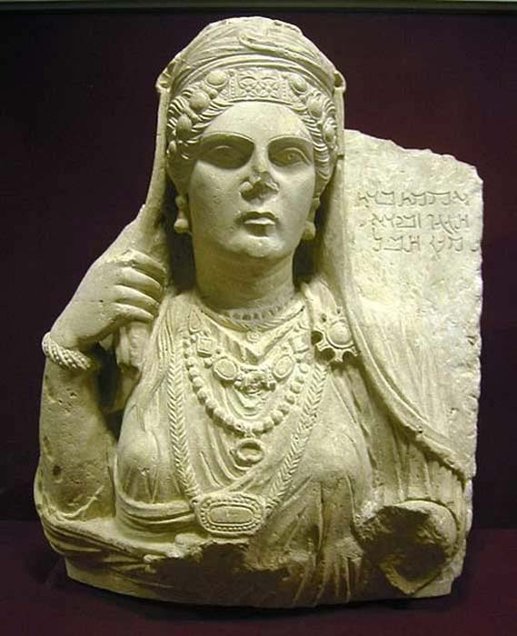 Funerary bust of Aqmat, daughter of Hagagu, descendant of Zebida, descendant of Ma'an, with Palmyrenian inscription. Stone, late 2nd century AD. From Palmyra, Syria. ( CC BY SA 3.0 )