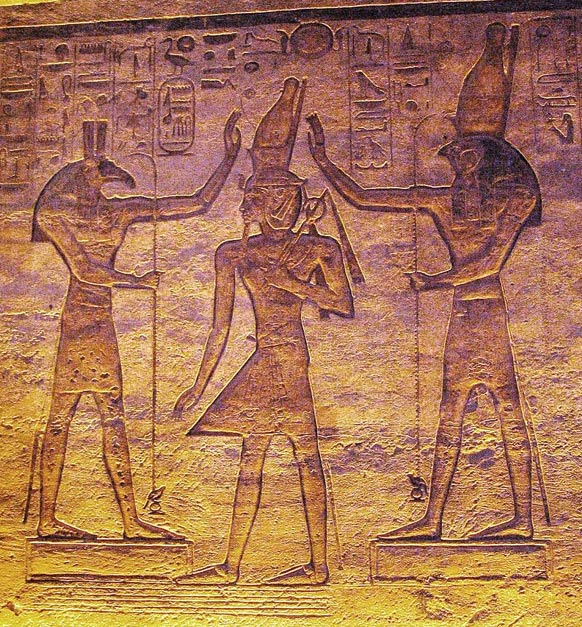 Gods Seth (left) and Horus (right) adoring Ramesses. Temple at Abu Simbel, Egypt.