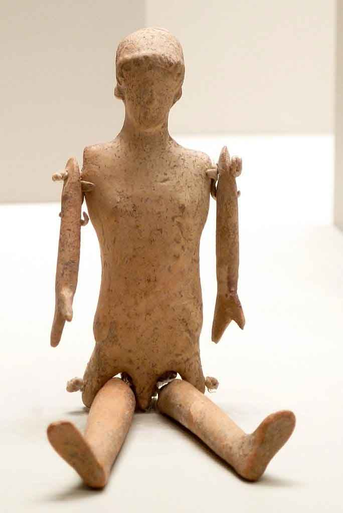An ancient Greek clay doll with moving body parts that is already quite sophisticated compared to the earliest dolls. This one isn't wearing any clothes but likely when it was last played with it was dressed. (Getty Villa / CC BY-SA 2.0)