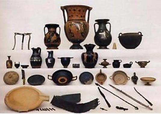 4th century assemblages with fine Greek vases, banquet implements and metal weapons.