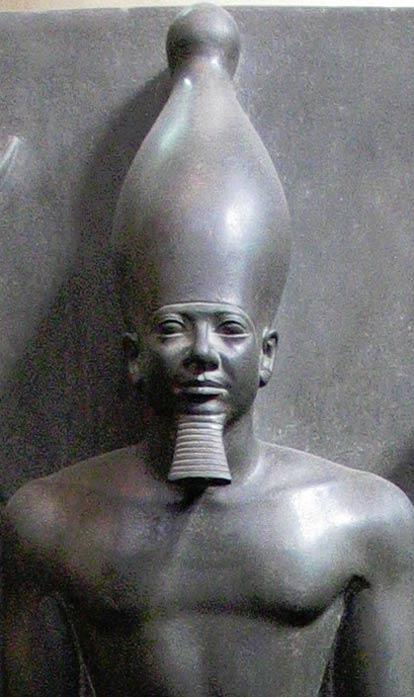 Greywacke statue of Menkaure, Egyptian Museum, Cairo.
