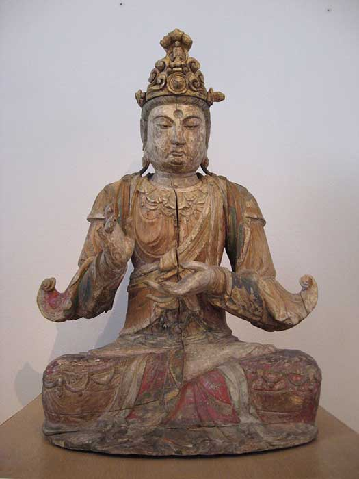 Guanyin, sitting in the lotus position.