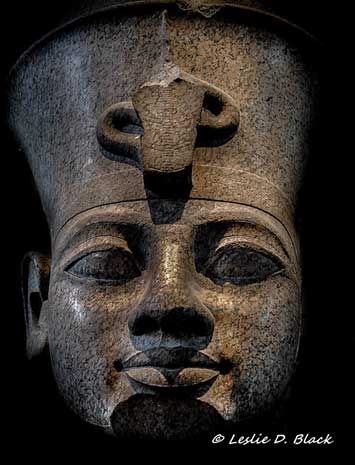 Head from a monumental red granite statue of Amenhotep III. This statue, wearing the double crown of Upper and Lower Egypt, was found in front of the temple of Khonsupakhered in the temple enclosure of Mut at Karnak. However, it is uncertain if it was originally erected there. British Museum.