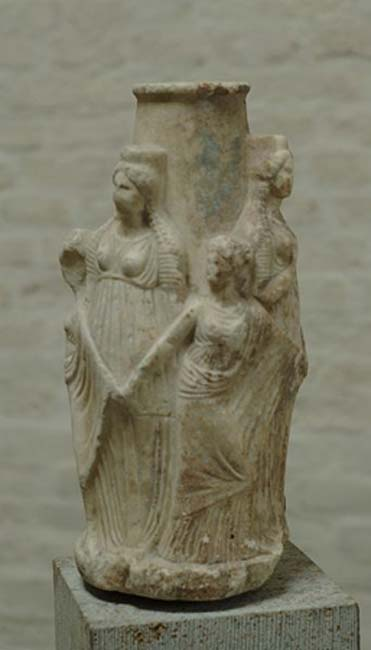 Hekateion (little votive column to Hecate). The triple-body goddess is surrounded by three dancing Charites. Attica, ca. 3rd century BC. (Public Domain)