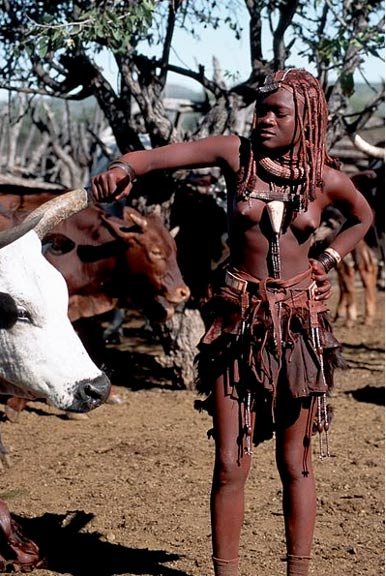 A Himba girl covered in body paint made with red ochre and milk fat