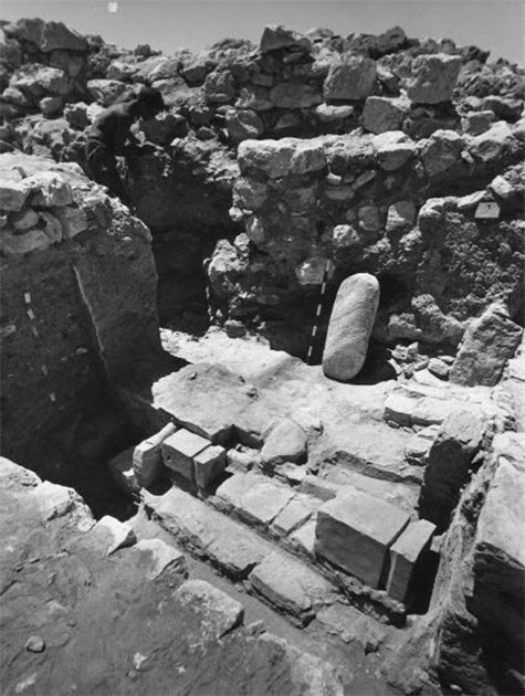 The Holy of Holies during excavation. The two lying altars are in their original position on the second stair (at the center of the photograph) facing north. (The Israel Museum, Jerusalem, S.J. Schweig Collection)