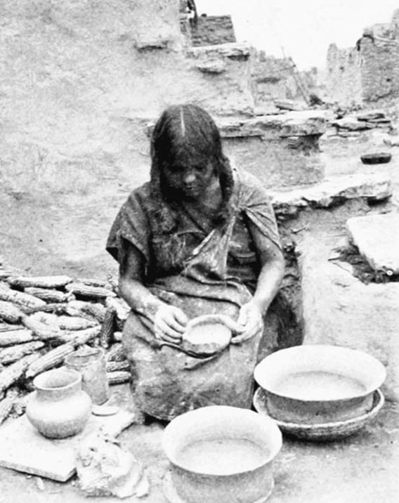 Hopi woman of Oraibi making coiled pottery, 1899.