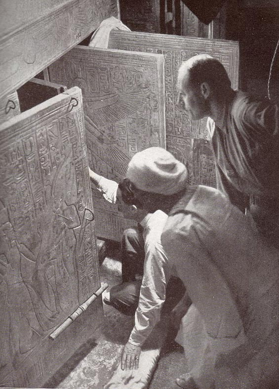 Howard Carter and associates opening the shrine doors in the burial chamber of Tutankhamun. 1924 reconstruction of the 1923 event