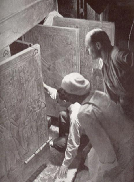 Howard Carter and associates opening the shrine doors in the burial chamber of Tutankhamen's tomb. (Public Domain)