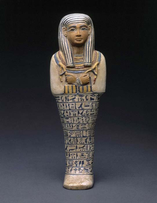 "In the Egyptian view, this image of a woman, Lady Sati, has a male face and hands because they are colored red—the ""male"" color. This use of color magically transformed Sati into a male being which gave her access to transportation to the next life in the Sun god Ra's boat. This shabti, made by a rare and expensive process using multiple colors of faience, was likely a product of a royal workshop. 18th Dynasty. Saqqara, Egypt. Brooklyn Museum. (Image: Brooklyn Museum)"
