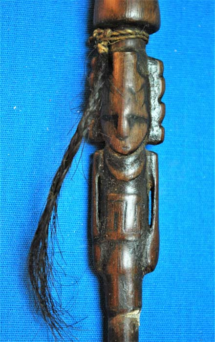 Intricately carved figure on a delicate snuffing tube. (José Capriles et al, Penn State)