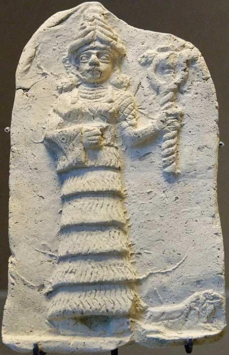 Ishtar holding her symbol