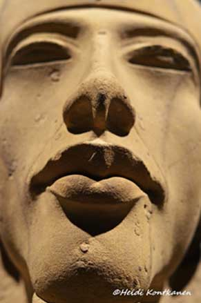 It is difficult to peer back through the mists of time and grasp the true philosophy of Akhenaten's new religion. We are left to fill in the missing pieces with informed speculation. This sculpted face of one of the king's colossal statues was found at Karnak Temple. Luxor Museum.