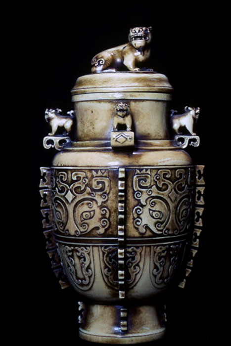 Ivory vase with cover, after the ancient bronze Hu.  Displaying the taotie (t'ao-t'ieh) and lions in its design.  Chinese, contemporary.  (Image: © Walther G. von Krenner)