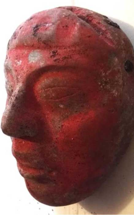 Jade mask from Burial 80, painted red with cinnabar paint.