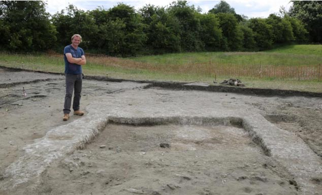 Jim Leary, lead archaeologist, with the remnants of the walls and the floor of the ancient home at Marden Henge. (University of Reading)