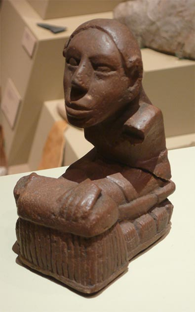 """The Keller figurine, one of several flint-clay statues from the Mississippian mound-building culture unearthed near Cahokia Mounds, was once seen by some scholars as a """"corn goddess"""" sitting on a row of corn cobs. (Public Domain)"""