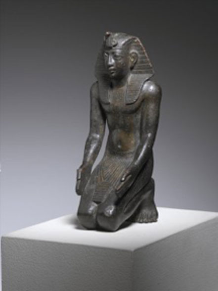 Kneeling Statuette of King Necho, ca. 610-595 BC. Bronze. (CC BY/Brooklyn Museum)