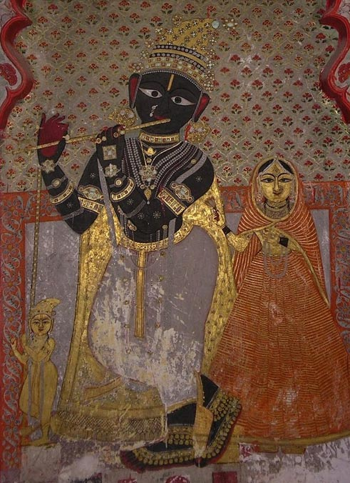 A 14th-century fresco of Krishna on the interior wall of City Palace, Udaipur. Pebble 101