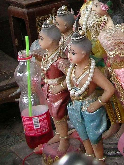Kuman Thong figures at a shrine in Ratchaburi Province.