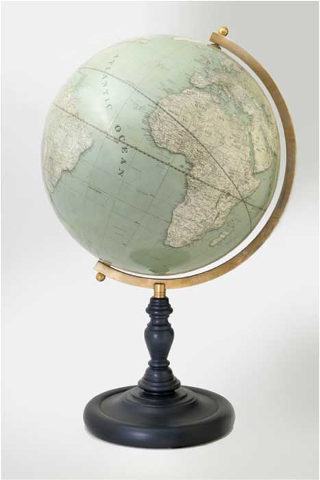 This Lander & May globe was produced in the same way British globes were made years ago: plaster is applied to a papier mache sphere and sanded so it's smooth. Then the workers apply the map applied in triangular pieces, then finish it with shellac and lacquer.