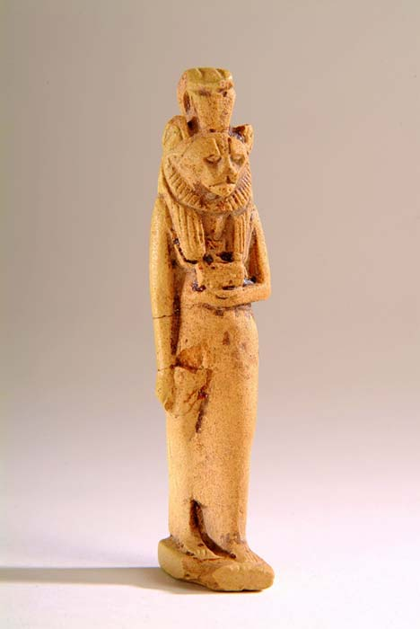 Large limestone amulet figurine of goddess Sekhmet, the lioness, holding the Eye of Horus Wedjat in her left hand. Harrogate Museums and Arts.