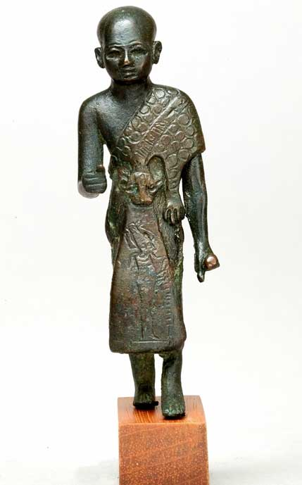Leaded bronze statuette of a sem priest wearing a leopard-skin cloak with an image of the god of the Underworld, Osiris, on his skirt. Third Intermediate Period or later. Metropolitan Museum of Art, New York. (CCO 1.0)