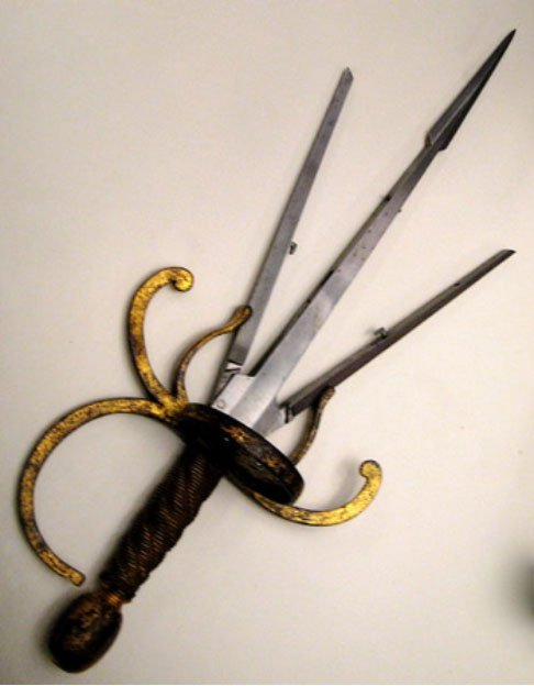 Left hand dagger with spring blades that can be opened by pressing a button, c. 1620.