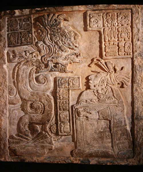 Lintel 15, now in the British Museum, depicting one of the wives of Bird Jaguar IV invoking the Vision Serpent in a bloodletting rite. Maya site of Yaxchilan, Mexico. (Michel Wal/CC BY-SA 3.0)