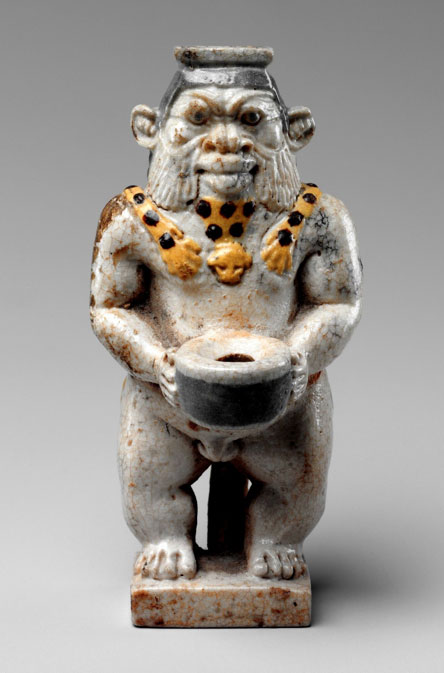 Made of faience, this squat human form with leonine features is commonly identified as the god Bes, but several other minor Egyptian gods were also represented by this image. These were protective deities, so they appear frequently as apotropaic figures in the decoration of furniture and personal belongings. Here, the god stands holding the cap of a kohl container. 27th Dynasty, Late Period. Metropolitan Museum of Art, New York.