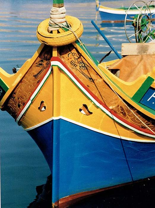 """A typical Maltese boat called luzzu has the symbol of the eye known as """"l-għajn,"""" which is said to protect fishermen from storms and malicious intentions. (-jkb-/CC BY-SA 3.0)"""