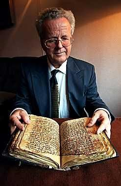 Martin Schøyen sits with the Gospel of Christ's own language from the 6th century.