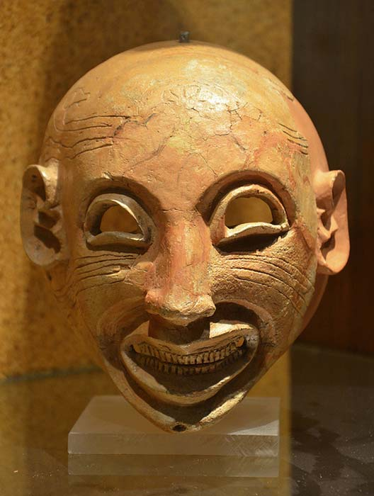 Mask showing a possible sardonic grin.