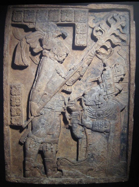 Maya relief at Yaxchilan of a royal blood-letting, depicting Lady Xoc [right] drawing a barbed rope through her tongue.