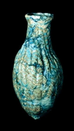 Mesopotamian fluted glass bottle (1300-1200 BC)